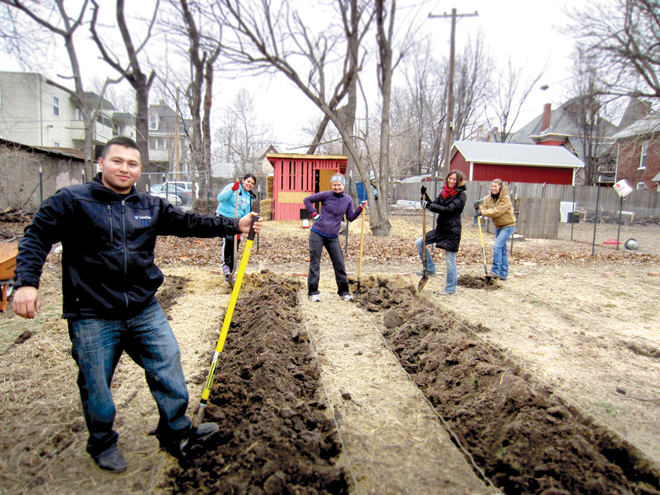 Donnelly College students Jhonatan Vallejo, Magali Rojas and Andrea Essner, and Avila University Intensive Language and Culture Program instructor Merriam Massey and Katie Frakes, a senior at Avila work clearing and preparing a community garden in Old Northeast Kansas City. (Photo courtesy of Donnelly College)