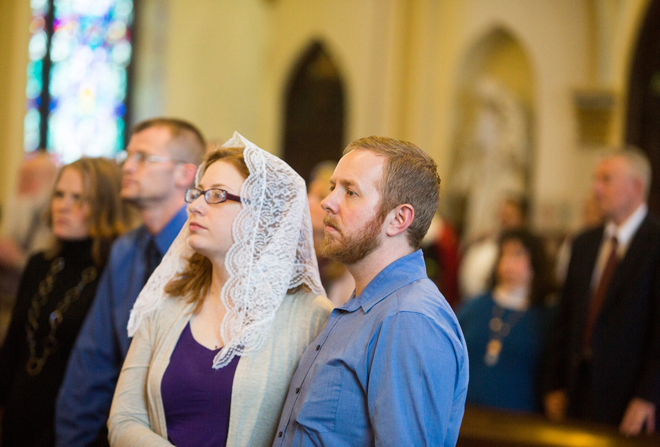 Married for 3 years, Chris and Jana Coffman, of St. Bridget Parish in Pleasant Hill, listen to Archbishop Naumann talk about marriage, at St. Peter's Cathedral in Kansas City, Kan., during the World Marriage Day Mass on Feb. 10. (Doug Hesse photo courtesy of The Leaven)