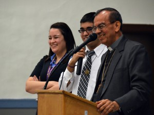 San Salvador Auxiliary Bishop Gregorio Rosa Chavez spoke to the students of Cristo Rey High School in Kansas City March 8 about the legacy of Archbishop Oscar Romero and how they can be agents of change for the good of the world. Interpreting for him were students Will Medina and Claudia Uribe. (Kevin Kelly/Key photo)