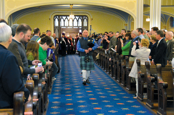 Piper John Feehan leads the procession as the annual Gaelic Mass begins March 9 at Our Lady of Perpetual Help (Redemptorist) Parish. At the close of the Mass, Feehan was installed into the Order of St. Patrick. (Kevin Kelly/Key photo)