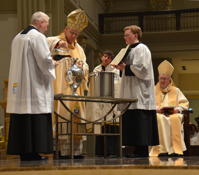 Bishop Robert W. Finn celebrates the annual Chrism Mass March 21 during which oils used in sacraments throughout the diocese are consecrated, and the assembled priests of the diocese renew their commitment to the vocation to which God has called them. (Kevin Kelly/Key photo)
