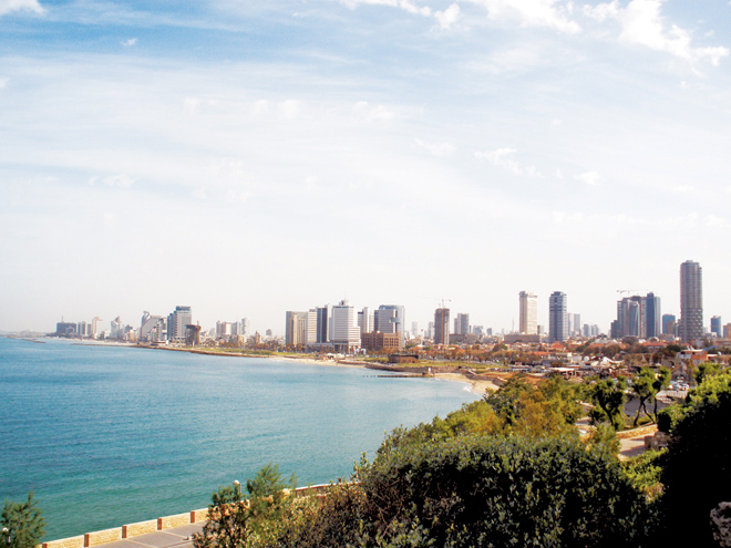 The modern city of Tel Aviv curves around the Mediterranean Sea. This was taken from the campus of St. Peter's Church in Jaffa, built on the site of the house where the apostle cured Tabitha. (Marty Denzer/Key photo)