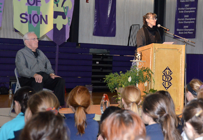 Notre Dame de Sion high school students listen as Stephanie Pino-Dressman, campus minister and theology instructor, reflects on the Holocaust and introduces Holocaust survivor, Roland Levi, during the school's annual Holocaust Memorial services April 8. (Marty Denzer/Key photo)