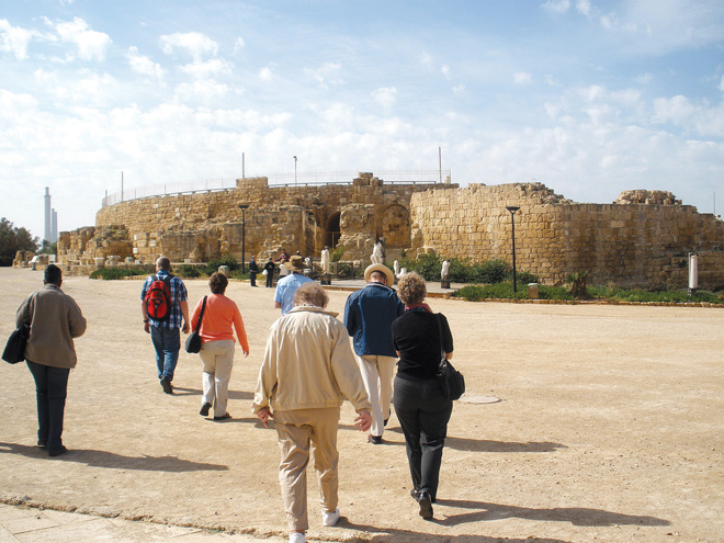 Pilgrims Debbie Buckley, Terry Lienhop, Joann Carroll, Dennis Carrol, Bill Vernon, Maggy Choplin and Jean Trapp walk toward the theater at Caesarea, built by Herod the Great, on the shores of the Mediterranean. (Marty Denzer/Key photo)