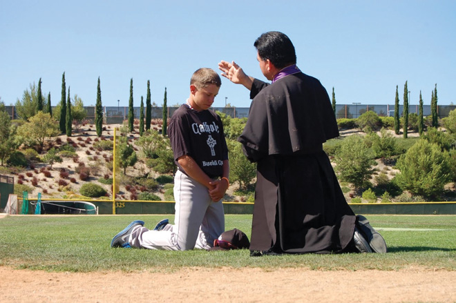A priest hears the confession of a camper at the first Catholic Baseball Camp held last year in San Diego. The camp is the new challenge of former Royals' slugger Mike Sweeney who is now seeking to win souls. Sweeney will bring the camp to the Kansas City area on June 4-6. (Photo courtesy of Mike Sweeney)
