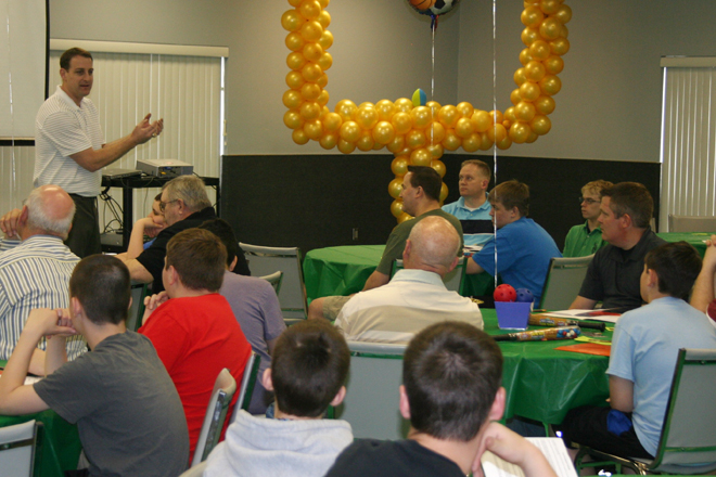 "Wes Simmons, Northwest Missouri Area Director for the Fellowship of Christian Athletes, explains to Training Camp participants how to ""Man Up!"" (Photo courtesy of Sara Kraft)"