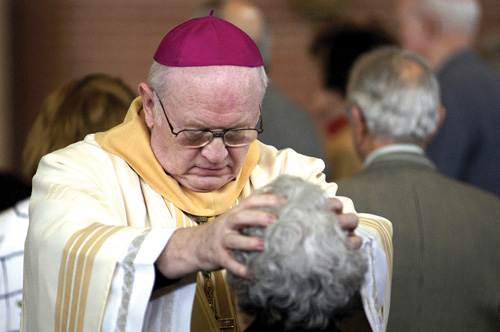Bishop Boland anoints an attendee at an Anointing Mass, sponsored by the Knights of Malta, Federal Association. The joint diocesan Mass is held annually for the sick, the elderly and those anticipating surgery. (Key file photo)