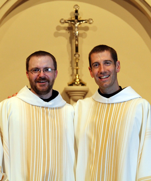 Father Victor Schinstock (on left) and Father Paul Sheller pause for a picture following their ordination to the priesthood May 16 at Conception Abbey. (Key Photo courtesy Greg Hodgson)