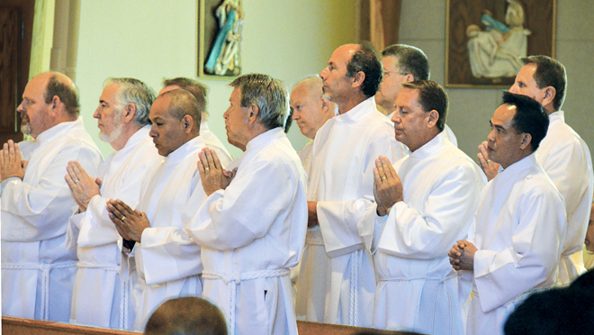 A class of 13 men, one of the largest the diocese has ever had, took a major step in their formation toward ordination as permanent deacons when Bishop Robert W. Finn installed them in the ministry of Acolyte. (Kevin Kelly/Key photo)