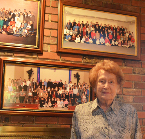 Rosemarie Maguire poses near photos of her family. (Marty Denzer/Key photo)