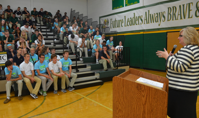 "Kelly Tyler Byrnes, Archbishop O'Hara Class of 1983, addresses the Class of 2014 at the end of the high school's ""Waking the Leader in You,"" a special day Aug. 28 for O'Hara students to hone their leadership skills. (Kevin Kelly/Key photo)"