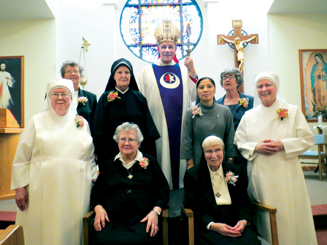 Eight of the 15 women religious who are celebrating jubilees pose with Bishop Robert W. Finn at the end of a Sept. 8 Mass at the chapel of the Sisters of St. Francis of the Holy Eucharist. They are (standing) Sister Emmanuel Joseph Donahue, lsp; Sister Kathleen Reichert, OSF; Mother Julia Mary Kubista, MM; Sister Pauline Nguyen, CMR; Sister Barbara McCracken, OSB; Sister Beatrice Mary Scully, OSB; (seated) Sister Matthias Igoe, OSB; Sister Bertilla Seiffert, OSB.