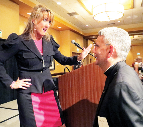 Rebecca Keissling speaks with Father Joseph Cisetti, pastor of St. Therese Parish in Parkville, after the annual fundraising dinner Sept. 26 for the Parkville Women's Clinic, a crisis pregnancy resource center. (Kevin Kelly/Key photo)