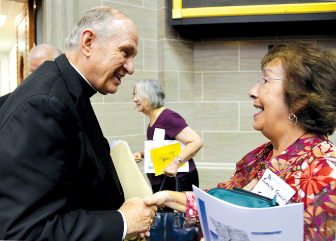 Des Moines Bishop Richard E. Pates speaks with Juanita Kunzler of Jefferson City following his keynote speech at the annual Missouri Catholic Conference Assembly Sept. 28 at the state capitol. (Kevin Kelly/Key photo)