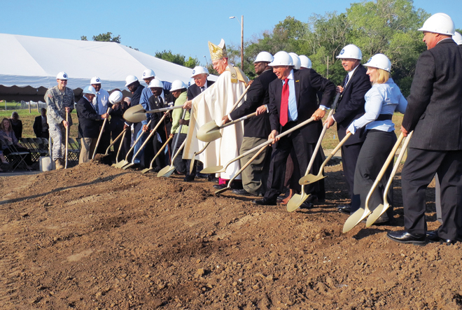 Bishop Robert W. Finn joins representatives from the public and private coalition that made the project possible in breaking ground Sept. 25 for St. Michael's Veterans Center that will provide housing and an array of services for homless military veterans. (Kevin Kelly/Key photo)