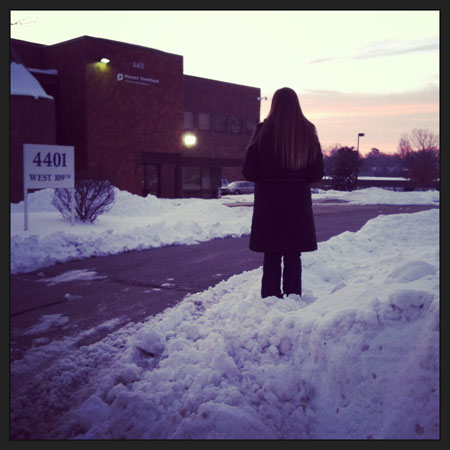 Diocesan Sidewalk Counseling Coordinator Julia Pickert waits to speak with women arriving at the Planned Parenthood abortion clinic in Overland Park.