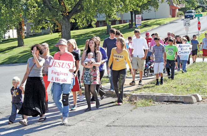 Pilgrims pray and walk during the two and a half mile pilgrimage for life from St. Francis Xavier Parish in St. Joseph to Bishop LeBlond High School, Oct. 13.  (Sara Kraft photo)