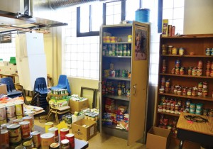 The food pantry at Our Lady of Guadalupe School fills a corner of the Reading Resource Room. The sister -school partnership between OLG and Notre Dame de Sion helped stock it. (Marty Denzer/Key photo)