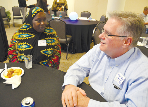 Mary Washington speaks with her TurnAround case manager Peter Brown at an Oct. 22 reception to highlight the successes of the Catholic Charities program that helps ex-offenders adjust to life outside prison. (Kevin Kelly/Key photo)