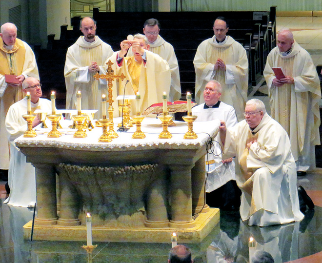 Bishop Emeritus Raymond J. Boland, left, joined Bishop Robert W. Finn and diocesan and religious order priests Nov. 24 in celebrating Mass at the Cathedral of the Immaculate Conception to close officially the global Year of Faith. (Kevin Kelly/Key photo)