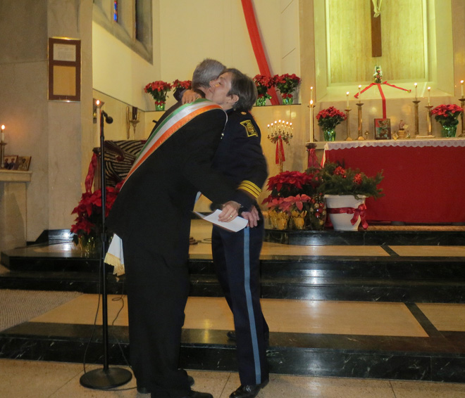 Kansas City Police Maj. Diane Mozzicato hugs Steve Lynch, president of the Ancient Order of Hibernians Padraig Pearse Division, at St. Therese Little Flower Parish after announcing that the Hibernians had donated a bench on the Trail of Heroes in honor of Officer John J. O'Sullivan, who was murdered in 1978. Every New Year's Day since 2010, the parish has revived a decades-long parish tradition of celebrating the first Mass of the New Year on the Solemnity of Mary, Mother of God, in honor of Kansas City's First Responders. (Kevin Kelly/Key photo)