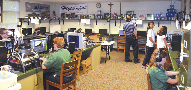 Students work in the iGeneration Tech Club room at St. Patrick's School. (Marty Denzer/Key photo)