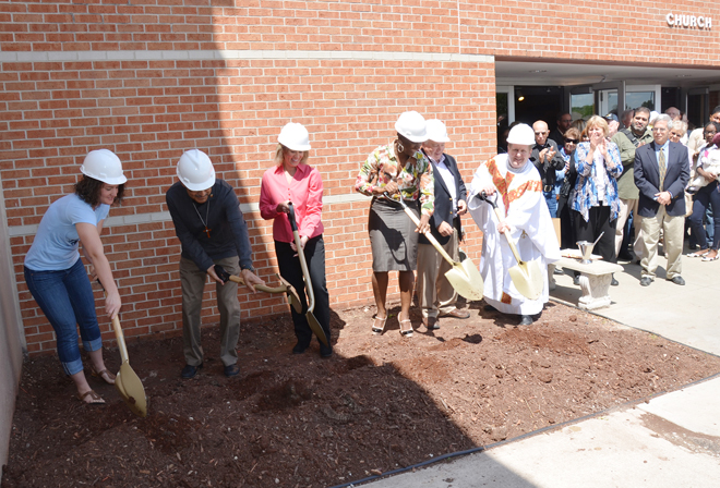 Kelly Lum, Tony Reyes, Cindy Bruner, Bertha Banlomon and David Kopek join pastor Father Sean McCaffery May 18 in breaking ground for a project that will construct an elevator at St. John Francis Regis Parish in Kansas City. (Kevin Kelly/Key photo)