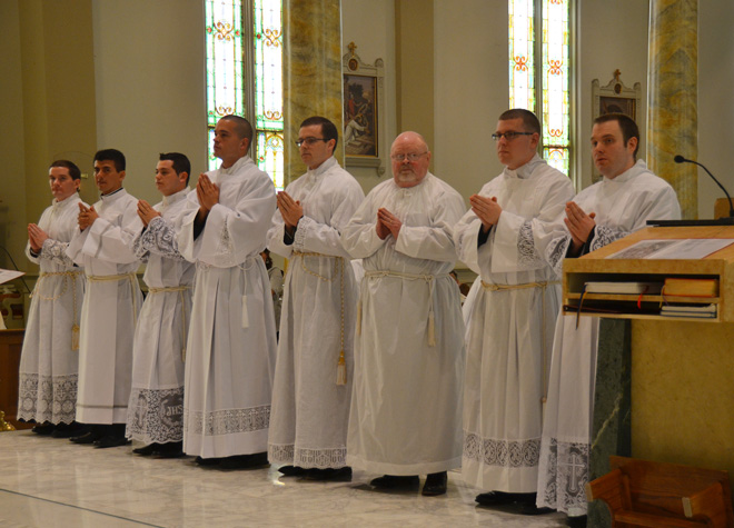 The eight men ordained to the transitional diaconate May 17 are, from left, Deacon Curt Vogel, Deacon Luis Felipe Suarez, Deaon Jorge Andres Moreno, Deacon Gabriel Lickteig, Deacon Ryan Koster, Deacon James Carlyle, Deacon Joshua Bartlett and Deaon Bryan Amthor. (Kevin Kelly/Key photo)