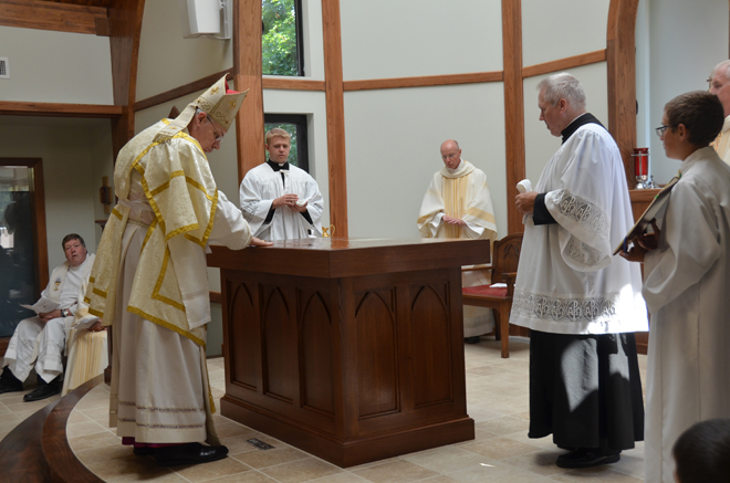 Bishop Robert W. Finn anoints the altar with Holy Chrism July 19 as he consecrates the new St.  Bartholomew Church in Windsor. (Kevin Kelly/Key photo)