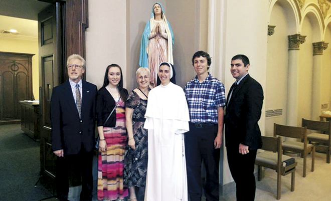 Bill and Margie Stump smile with their daughters Sister Mary Gemma and Bethany, and sons Kevin and Dan in the Cathedral of the Incarnation in Nashville following her first profession of vows as a Dominican Sister of the Congregation of Saint Cecilia, July 28. (Photo/courtesy Bill and Margie Stump)