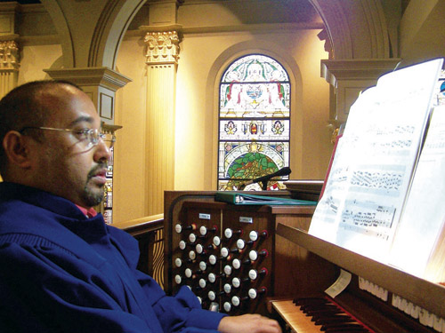 Dr. Mario Pearson plays the Cathedral's Rufatti/Rodgers organ. (photo courtesy of the Cathedral)