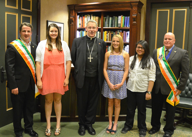 Lexie Chirpich, Brenna Killen and Diana de la Cruz , winners of the 2014 Ancient Order of Hibernians scholarships pose with Garin Nolan, Bishop Robert W. Finn and Joe Flanagin before the awards presentations, Aug. 14. (Marty Denzer/Key photo)