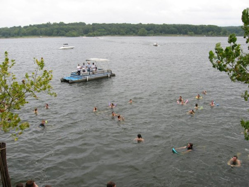 Young adults pontoon boating, swimming and having a great time at Nature's Call camp out at Lake Pomme de Terre, in a previous year. (photo courtesy David DiNuzzo)