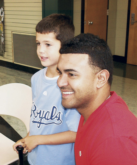 "Superfan Cohen Robinson poses with Kansas City Royals infielder Christian Colon who came to Archbishop O'Hara High School with six other Royals Aug. 8 to support teammate Billy Butler's ""Hit It A Ton"" campaign to feed the hungry. Butler donates a ton of food to the Bishop Sullivan Center and St. James Place food pantry for every home run he hits and has encouraged hundreds of people to join him. (Kevin Kelly/Key photo)"