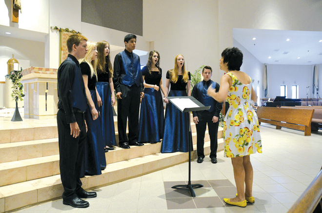 The Sarton Singers from St. Pius X High School, under the direction of Sandy Prothman, led the music at the annual Mass and convocation for Catholic school teachers Aug. 8 at St. Therese Parish in Parkville. (Kevin Kelly/Key photo)