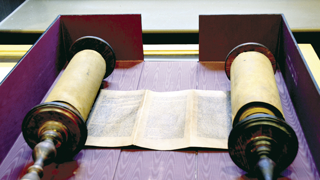 Two of the historic documents in the Wisdom of the Ages exhibit, which opened Sept. 11 at Benedictine College in Atchison, Kan. (above) A 16th century Torah scroll handwritten on animal skin, probably deerskin; and (below) a Manuscript Bible, hand-written and illuminated by Benedictine monks, c.1220. (Marty Denzer/Key photo)
