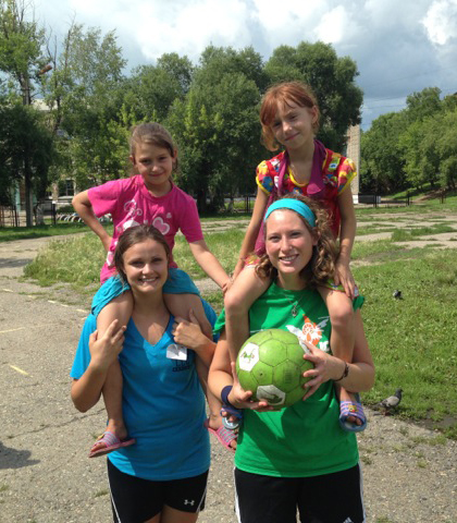 The Mission leader, Teresa Nuar, in green, with Lizzie Miller (a student from Baylor University) and two children from the kids' camp, week one. (photo courtesy Father Steve Hansen)