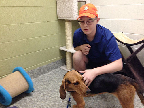 """Seminarian Wesley McKellar and Sophie relaxing in his basement room. Sophie provides """"great companionship"""" when her master is home alone. (Photo/courtesy Wesley McKellar)"""