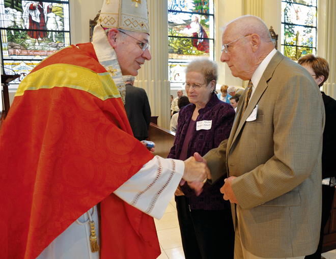 Jim and Rose Scanlon received special pins from Bishop Robert W. Finn as did some 75 parish volunteers from throughout the diocese Sept. 14 at the annual Bishop's Recognition Award Mass at the Cathedral of the Immaculate Conception. (Kevin Kelly/Key photo)