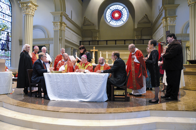Bishop Robert W. Finn and other officials sign documents proposing the canonization of Sister Marie de Mandat-Grancey at the Cathedral of the Immaculate Conception on Sept. 13. (Kevin Kelly/Key photo)