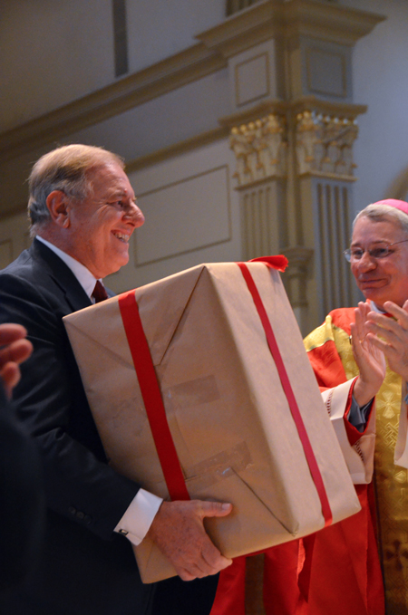 Attorney Andrea Ambrosi holds the sealed box containing documents for the sainthood cause of Sister Marie de Mandat-Grancey. (Kevin Kelly/Key photo)