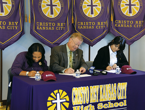 Cristo Rey High School student interns sign contracts with company CEOs. (Marty Denzer/Key photo)