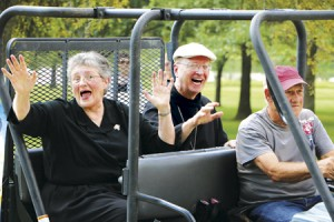 Sr. Rita Clair Dohn, OSB, Prioress of the Benedictine Sisters of Perpetual Adoration, and Abbot Gregory Polan, OSB, Abbot of Conception Abbey, enjoy their ride in the 14th Annual Lollipop Parade, serving as this year's Grand Marshals.  (photo courtesy of Fr. Paul Sheller, O.S.B.)