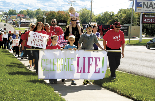 Participants in the Life Day Celebration carry signs and walk on the Belt Highway, one of the busiest streets in St. Joseph to show their support for life. (photo courtesy Sara Kraft)
