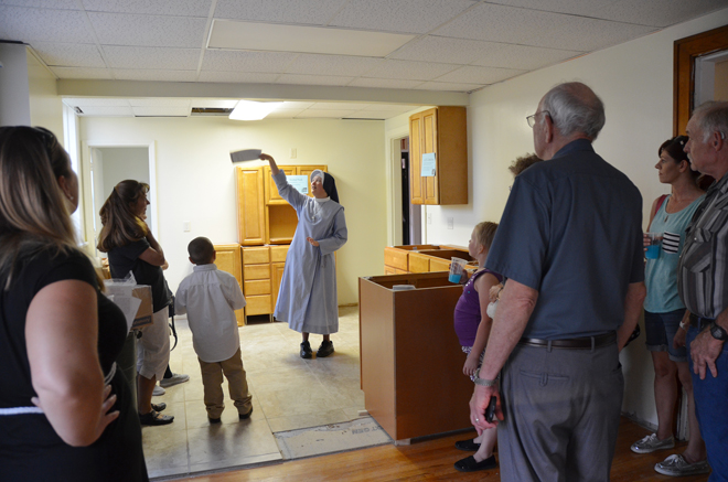 Sister Teresa Marie leads the parishioners of St. James in St. Joseph on a tour of the 1927 convent that is being remodeled and renovated for the School Sisters of Christ the King. (Kevin Kelly/Key photo)