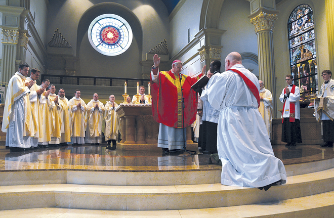 Bishop Robert W. Finn ordains Father James Carlyle to the diocesan priesthood Oct. 18 at the Cathedral of the Immaculate Conception. (Kevin Kelly/Key photo)