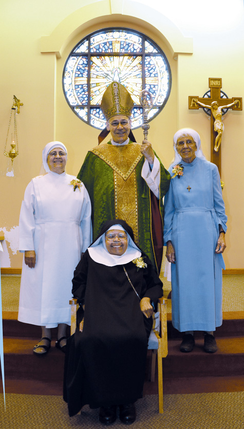 Clockwise from the right, Sister Helen Groudis, Sister Wilhemina Lancaster and Sister Gonzague of St. Chantal were honored for their jubilee years Oct. 19 at a Mass celebrated by Bishop Robert W. Finn at the Our Lady of the Angels Chapel of the Sisters of St. Francis of the Holy Eucharist. (Kevin Kelly/Key photo)
