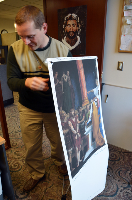 Diocesan Youth Ministry director Mike Nations prepares Stations of the Cross banners for the upcoming Kansas City Youth Conference Nov. 22-23 at the Sheraton Crown Center Hotel in Kansas City. (Kevin Kelly/Key photo)