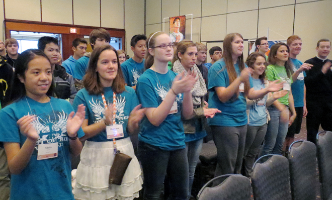 The Life Teen group from St. Andrew Parish in Gladstone gets into the rap music of Righteous B during the Nov. 22 Kansas City Youth Conference at the Crown Center Sheraton Hotel in Kansas City. (Kevin Kelly/Key photo)