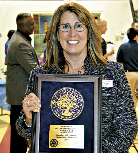 Principal Jodi Briggs with the plaque proclaiming Presentation a National Blue Ribbon School.  (Marty Denzer/Key photo)